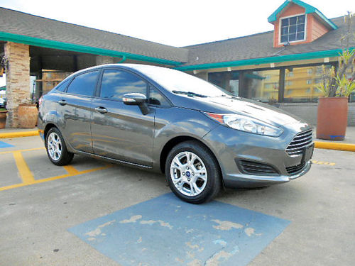 15 FORD FIESTA LUXURY AUTO 22K MILLAS TELEC AC CD 713 780-1616 10850