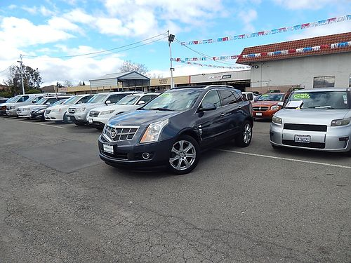 2010 CADILLAC SRX - AWD Premium Collection auto PW PL CD prem sound Bluetooth DVD spoiler r