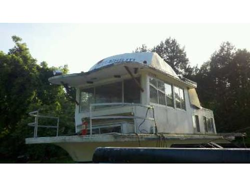 HOUSEBOAT Older Gibson runs but needs to be remodeled kitchen shower bathroom on trailer incl