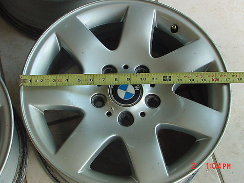 BMW 325I WHEELS off 2004 model may fit other years 4 total 1 rim is bent hit pothole 17x8