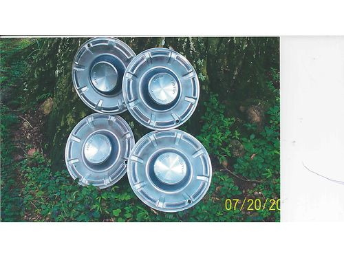 HUBCAPS Set of 4 off 1970 first year made Ford Maverick 14 wFord Motor Company Logo on center