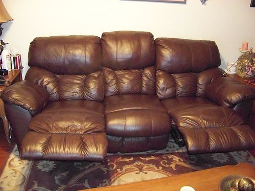SOFA Brown top grain leather 90 with dual recliners near perfect condition 700 865-922-8282