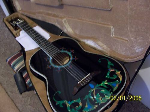 GUITAR American Legacy Acoustic Electric wAir Lite case sell for 275 or trade for hand gun 865