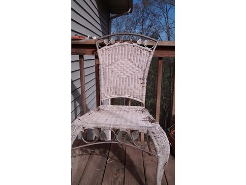 WICKER CHAIR Antique 200- yrs old wmetal leaves on top  bottom woven whicker seat pretty