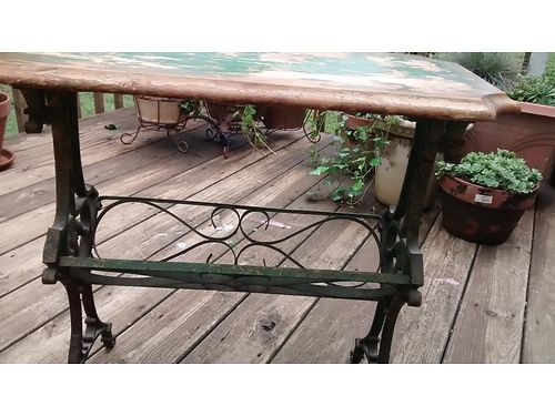 CAST IRON SIDE TABLE wmetal scroll work at bottom 60 865-765-7598 see photo at wwwrecyclercom