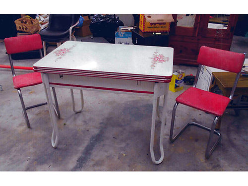 TABLE Retro from the 1930s-1950s w2 red  metal chairs enamal top wfloral desgin metal leg