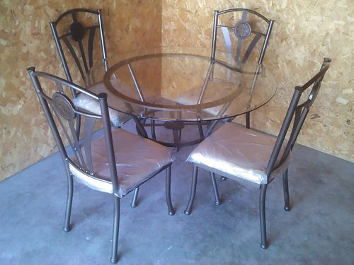 TABLE  CHAIRS These are made of glass and metal with very comfortable well padded seats 175 865-