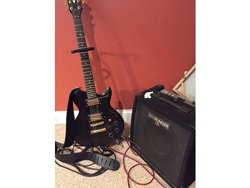 ELECTRIC GUITAR Washburn Rarely used Comes with Behringer amp 300 Kathryn 865-274-9652 see p