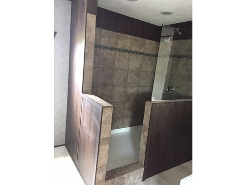 THE MEGA HOUSE IS A MUST SEE Huge ceramic shower stall Built in entertainment center and large ki