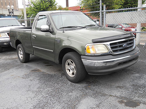 2002 FORD 150 short bed green good truck looks  runs good v8 auto loaded high miles 4250 MER