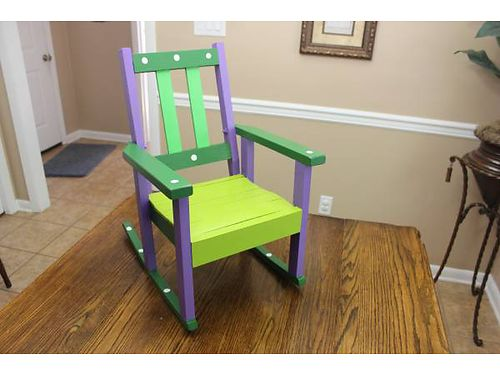 CHILDS FOLK ART ROCKING CHAIR painted in various bright colors 25 865-482-3669 see photo at ww