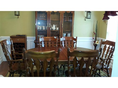 DINING ROOM SUITE Solid oak table w4 10 leaf  pad 6 chairs 2 captains 4 regular 3 door lig