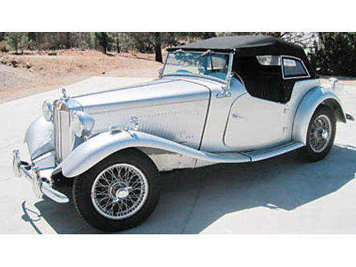 1952 MG TD with MG Wire wheels and full side curtains 1974 Nissan overhead cam engine and 4 speed t