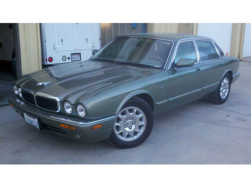 1999 JAGUAR XJ 8 - 40L auto clmt cntrl 6 CD lthr pseats sunroof abstrctn cntrl all pwr a