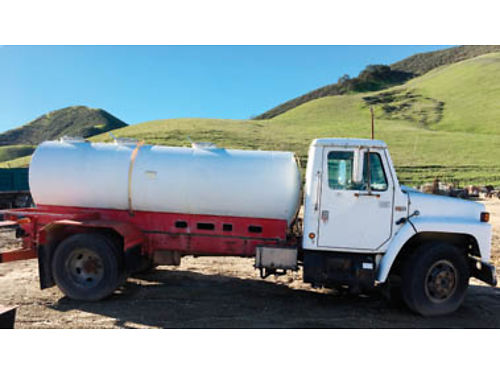1983 INTERNATIONAL water truck 1000 gallon stainless steel tank PTO Call for price and more inform