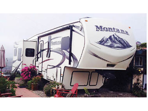2015 MONTANA 38 Home-like floorplan Many extras detailed woodwork lg kitch bar and table cen