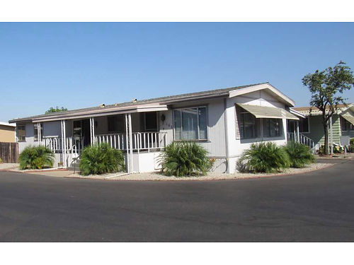 SPACE 166 This 1974 Dual Wide is a new listing in a 55 Community in Del Cielo Mobile Estates Wit