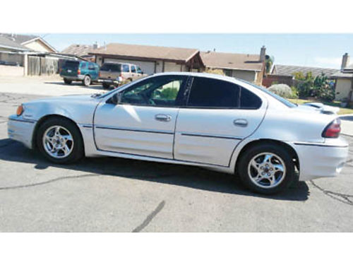 2002 PONTIAC 4 door Automatic silver moonroof tinted windows tagged to 2018 clean title Grea