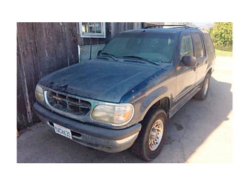 1998 FORD EXPLORER Needs new transmission and a new fuel pump Passenger door wont open We are ac