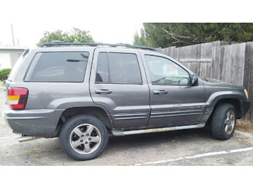 2002 JEEP GRAND CHEROKEE Runs good needs a door window pricing for a quick sa