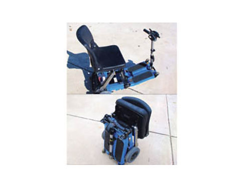 LUGGIE ELECTRIC WHEELCHAIR new battery 50lb approximate weight folds into suitcase size 1200 V