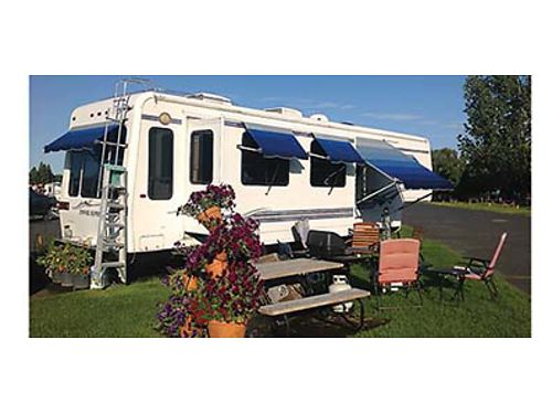 1999 36 FT Travel Supreme Fifth Wheel 3 slides 5 awnings AC units Ceramic tile  carpeting Ent