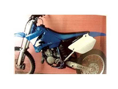 2003 YAMAHA YZ125 motorcycle slightly used with a new back tire and new fender and carb kit runs e