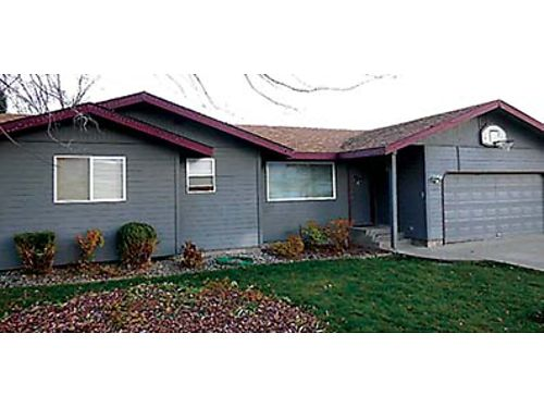 WONDERFUL HOME This 4 bedroom 3 bath East Wenatchee home features living and family rooms with laun