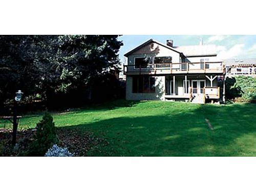 PRIVATE WATERFRONT Two story Peshastin home with 85 of level riverfront features 3 bedrooms hardw