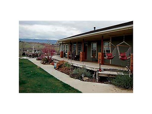 BREATHTAKING VIEWS Cozy rambler on 5 acres in Malaga with open concept living features 1500 SqFt