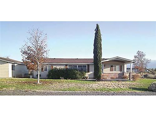 DESERT AIRE 3 bedroom 2 bath manufactured home Offers detached garage shop on a well landscaped