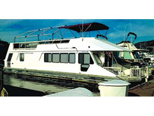 1987 52 X 14 3 Buoys Sunseeker Houseboat docked at the Two Rivers Marina Volvo Penta 140hp West
