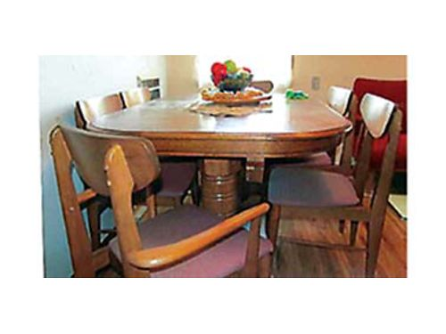 DINING room set 60 x 42 6 place expanable to 8 place when expanding legs stay- top slides with g