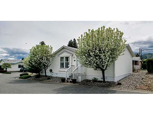 LOVINGLY CARED FOR 3-bed 2-bath home with cathedral ceilings in well-maintained 55 community 7500