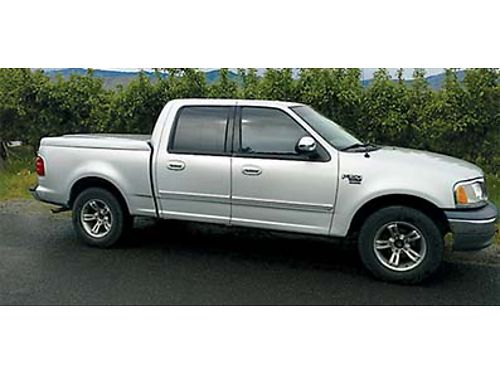 2002 FORD F150  2WD super crew cab 4 doors tunnel cover linex bed Includes snow tires and rims
