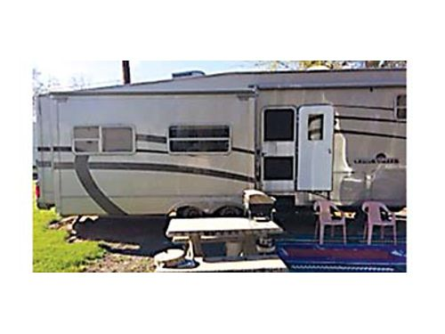 2003 CEDAR CREEK 5th wheel RV 34 long 3 slides New refrigerator hot water tank tires stainles