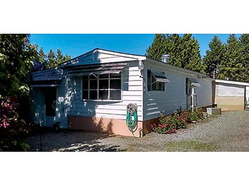 1979 10 X 70 Mobile Home with 4 foot addition and newer shingled roof 3 beds 2 bath and single c