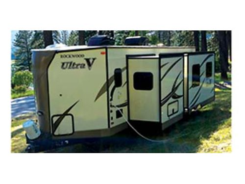 2016 ROCKWOOD Ultra V like new loaded two slides many extras including new memory foam mattress