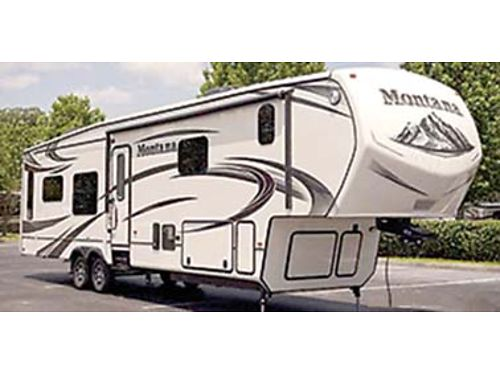 2015 MONTANA 3402RL fully loaded auto levelers K -bed 2 TVs 4 slides double refrigerator dua