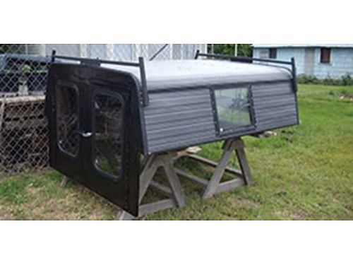 MID size truck canopy 5ft w x 6ft long full rear doors nice condition 160 OBO 509-532-8456