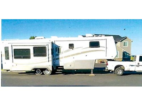2004 MOBIL SUITES 36 3 slides dual air excellent condition new tires 2 auto awnings cargo sli