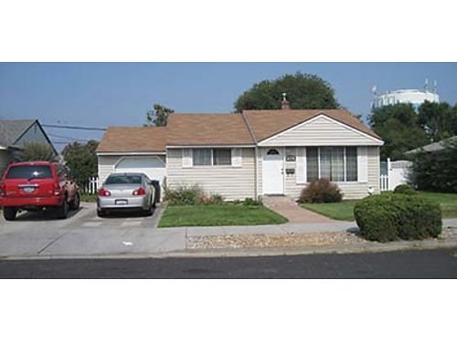 UPDATED and affordable Moses Lake home with single car garage and extra paved off street parking fe