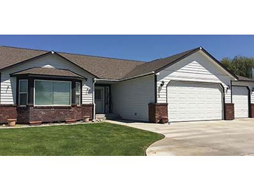 3 BEDROOMS 2 baths triple garage and a finished 24x30 shop New carpet and hardwood flooring Is