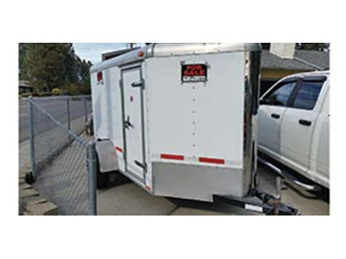 CONTINENTAL cargo 5x12 motorcycleutility trailer carpeted tie downs rear fold down and side door