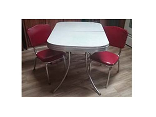 KITCHEN table w4 dining chairs Rectangle table features a white finish and chrome rimmed top Cha