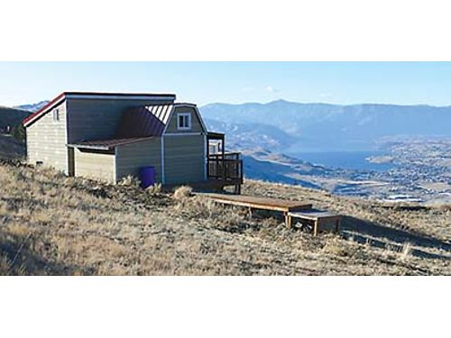 OFF-GRID LIVING Incredible valley views from this 52 acres in Orondo with 2 off grid cabins adjoine