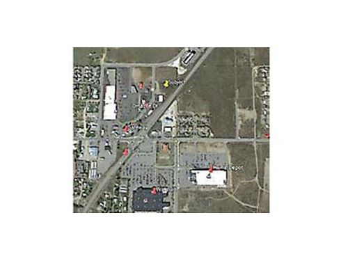 OMAK COMMERCIAL LOT On US 97 at the main intersection in Omak diagonally across the intersection fro