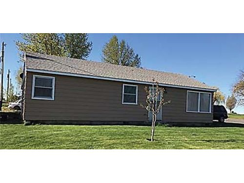 705 W 9TH STREET This well maintained Warden home is on a corner lot Laminate flooring in living k