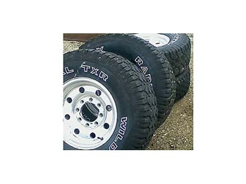 FOUR LT26575R16 Wild Country Radial TXRs on aluminum wheels Will fit 1996 and earlier F250 Ford