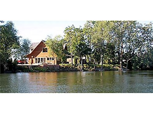 CUSTOM WATERFRONT HOME With natural wood inside  out Open floor plan with high end finishes Swee